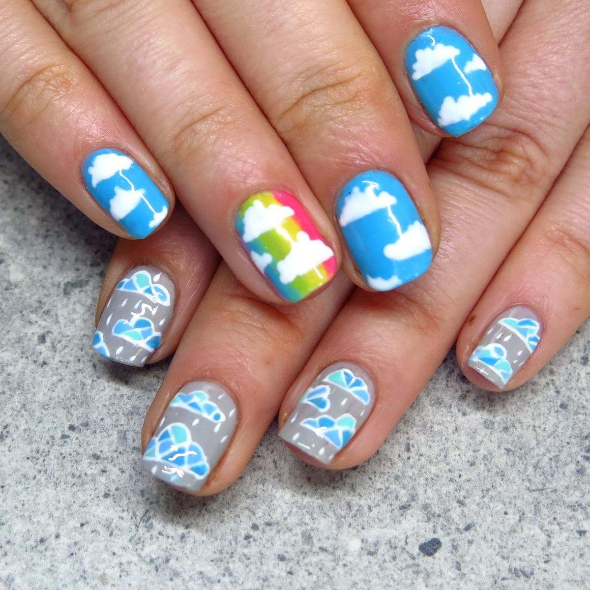 zdobienie paznokci na lato wzory w chmurki i tęczę tęczowe zdobienie stylizacja paznokci na urlop wakacje
